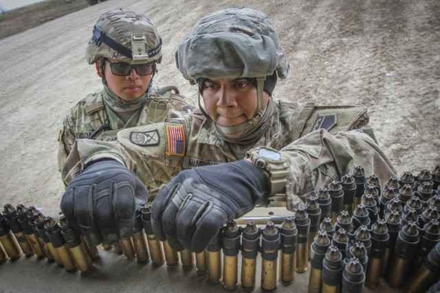 Army Reserve Spc. Ricardo Manriquez (right), a communication specialist and native of Sylmar, California, assigned to the 307th Chemical Company, 453rd Chemical Battalion, 209th Regional Support Group, 76th Operational Response Command links blank .50 caliber ammunition together in the back of a vehicle at Fort Riley, Kansas, April 4, as Spc. James Cadaoas, a chemical, biological, radiological and nuclear (CBRN) specialist and native of Carson, California, also assigned to the 307th Chem. Co, supervises. More than 450 Army Reserve Soldiers from around the country are participating in a three-week gunnery exercise here entitled Operation Gauntlet, which is designed to hone crucial gunnery skills and increase battlefield lethality.  (Official U.S. Army Reserve photo by Sgt. 1st Class Brent C. Powell)