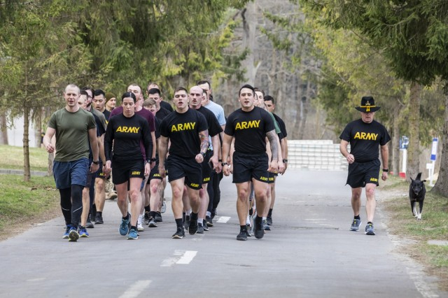 Multinational Soldiers and civilians from the 278th Armored Cavalry Regiment, Lithuania and Ukraine finish a four-mile run during the Spur Ride event held at the Yavoriv Combat Training Center, Ukraine, April 5.