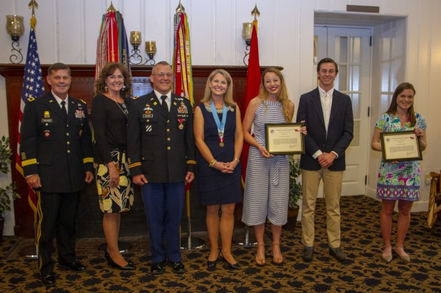 "Col. Gary ""Eddie"" Gillon Jr, center,  poses for a picture with (from left to right) Maj. Gen. Flem B. ""Donnie"" Walker Jr., commanding general, 1st Theater Sustainment Command, Hope Walker, wife Amy Gillon, daughter Megan (Gillon) Hensley, son-in-law Jerod Hensley and daughter-in-law Kaiti Gillon. (U.S. Army photo by Spc. Zoran Raduka)"