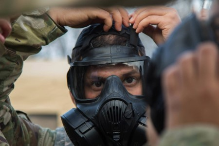 A Soldier dons his gas mask during the Gunslinger Challenge on Fort Hood, Texas, March 7, 2019. The Gunslinger Challenge is a quarterly competition the 553rd Combat Sustainment Support Battalion, 1st Cavalry Division Sustainment Brigade, uses to build morale across the organization.