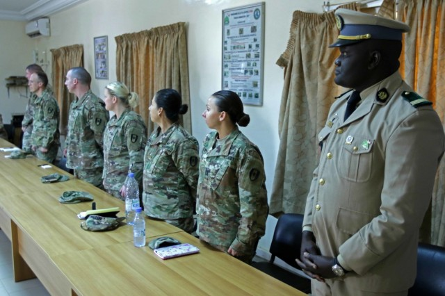Senegalese and American military participate in the opening ceremony at the Hospital Military De Ouakam, Senegal, during Medical Readiness Exercise 19-2, 8 April 2019. Medical Readiness Exercises provide a real-world environment where medical professionals from both militaries can build and strengthen medical treatment capability and capacity by honing their medical skills in alternative conditions while also learning different protocols from their counterparts.