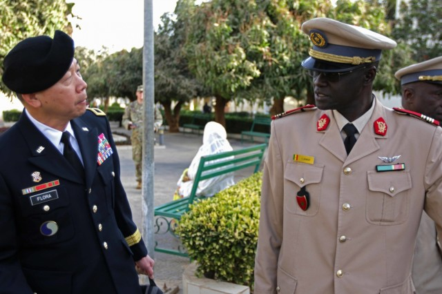 U.S. Army Africa Deputy Commanding General Brig. Gen. Lapthe Flora and Senegalese Deputy Health Serice Director of Medicine Col. Diene takes a tour of Hospital Military De Ouakam, Senegal, during Medical Readiness Exercise 19-2, 8 April 2019. Medical Readiness Exercises provide a real-world environment where medical professionals from both militaries can build and strengthen medical treatment capability and capacity by honing their medical skills in alternative conditions while also learning different protocols from their counterparts.