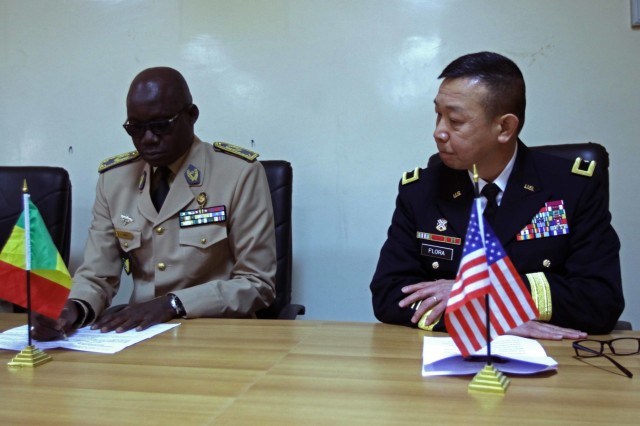 U.S. Army Africa Deputy Commanding General Brig. Gen. Lapthe Flora and Senegalese Administer of Health Col. Ibrahima Diouf give remarks for the opening ceremony at the Hospital Military De Ouakam, Senegal, during Medical Readiness Exercise 19-2, 8 April 2019. Medical Readiness Exercises provide a real-world environment where medical professionals from both militaries can build and strengthen medical treatment capability and capacity by honing their medical skills in alternative conditions while also learning different protocols from their counterparts.