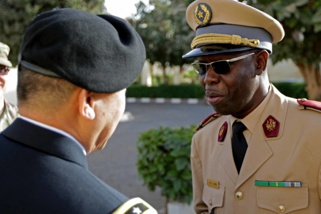U.S. Army Africa Deputy Commanding General Brig. Gen. Lapthe Flora and Senegalese Deputy Health Serice Director of Medicine Col. Diene meets at Hospital Military De Ouakam, Senegal, during Medical Readiness Exercise 19-2, 8 April 2019. Medical Readiness Exercises provide a real-world environment where medical professionals from both militaries can build and strengthen medical treatment capability and capacity by honing their medical skills in alternative conditions while also learning different protocols from their counterparts.