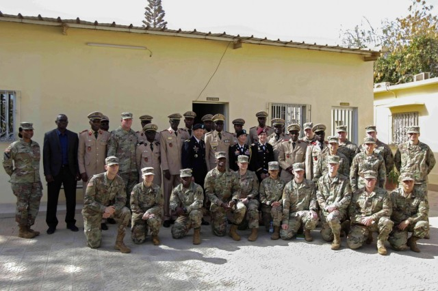 U.S. Army and Senegalese medical professionals gather for a group photo at the Hospital Military De Ouakam, Senegal, during Medical Readiness Exercise 19-2, 8 April 2019. Medical Readiness Exercises provide a real-world environment where medical professionals from both militaries can build and strengthen medical treatment capability and capacity by honing their medical skills in alternative conditions while also learning different protocols from their counterparts.