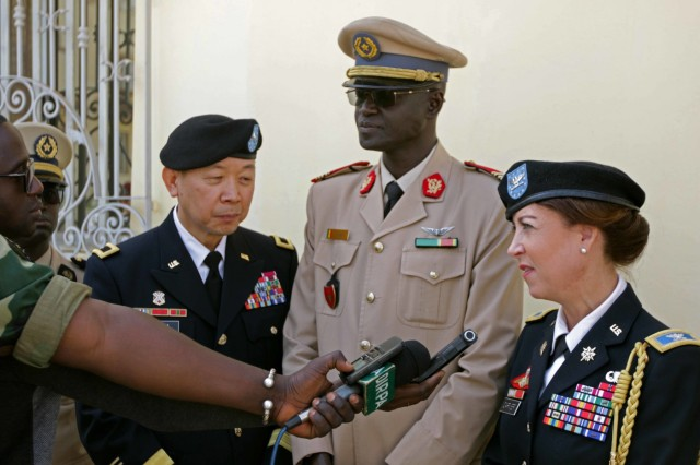 U.S. Army Africa Deputy Commanding General Brig. Gen. Lapthe Flora, Senegalese Administer of Health Col. Ibrahima Diouf and U.S. Embassy of Senegal Defense Attache' Col. Gwyn Carver are interviewed by the Senegal Government radio station at Hospital Military De Ouakam, Senegal, during Medical Readiness Exercise 19-2, 8 April 2019. Medical Readiness Exercises provide a real-world environment where medical professionals from both militaries can build and strengthen medical treatment capability and capacity by honing their medical skills in alternative conditions while also learning different protocols from their counterparts.
