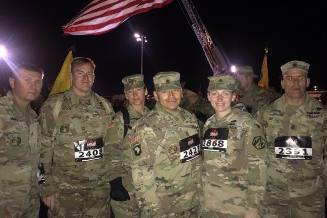 Soldiers with 1st Battalion, 48th Infantry Regiment, pause for a photo before the march begins.