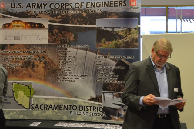 An attendee reads pamphlet giving an overview of the Sacramento District during the Business Opportunities Open House on March 27, 2019, in Sacramento, California. The BOOH gives contractors a chance to meet representatives from the Corps, learn about upcoming contract opportunities and network with other potential contractors.