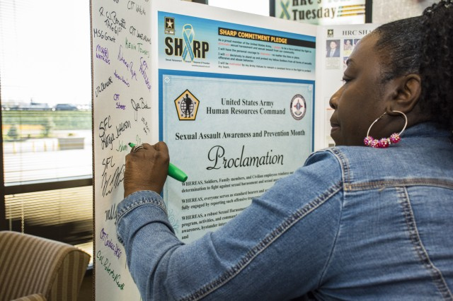 A member of U.S. Army Human Resources Command at Fort Knox, Kentucky, signs a pledge April 9, 2019, to do her part in addressing and preventing sexual assault and harassment. Several signed the pledge throughout the day in celebration of Teal Tuesdays.