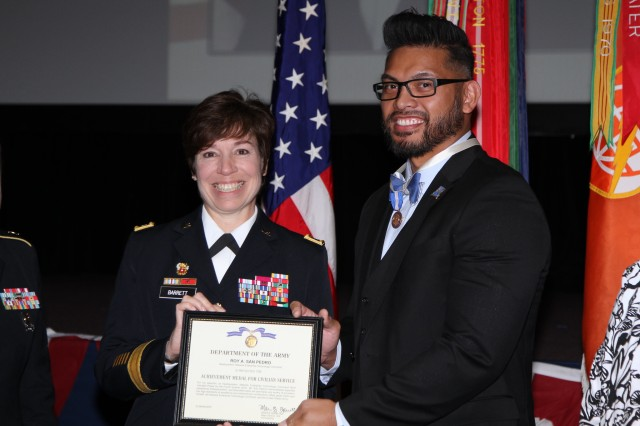 Roy San Pedro, an intelligence specialist for NETCOM, receives the Achievement Medal for Civilian Service from NETCOM CG, Maj. Gen. Maria Barrett, during an awards ceremony April 9, on Fort Huachuca.  San Pedro was selected as the command's Most Valuable Player of the Year, 2018.