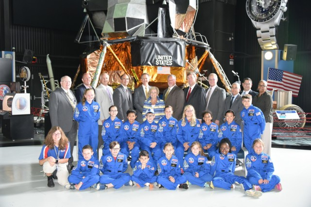 Members of the Air, Space, and Missile Defense Association pose with prior recipients of the ASMDA Space Camp scholarship at the U.S. Space and Rocket Center in Huntsville, Alabama. Since 1996, ASMDA has sent more than 200 students to Space Camp.