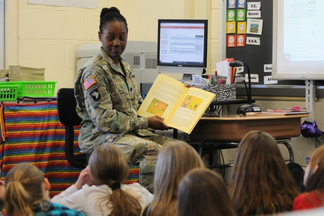 "Lt. Col. Donna Simms, the 20th Chemical, Biological, Radiological, Nuclear, Explosives (CBRNE) Command Assistant Chief of Staff, Budget (G8) reads 'The Magic of the Old Oak Tree', a book she wrote for her kids when they were young, to a class of students at Churchville Elementary School. Elementary schools across the nation celebrated 'Read Across America' during the month of March which ""calls for every child in every community to celebrate reading"" and recognizes children's author, Dr. Seuss, whose birthday is March 2."