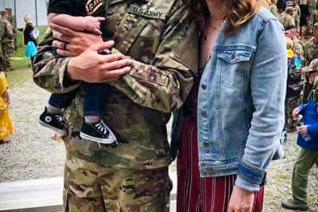 FORT BENNING, Ga. - Staff Sgt. Austin Forby, his wife, Emily, and their son, Kason, reunite at the conclusion of the Ranger School Class 04-19 graduation ceremony at Fort Benning, Georgia, April 5, 2019. Ranger School is a 61-day combat leadership course designed to test the physical and mental toughness of Soldiers who want to join the elite ranks of U.S. Army Rangers, or those who desire to master the fundamentals of small-unit tactics. (U.S. Army photo courtesy by the Forby family)