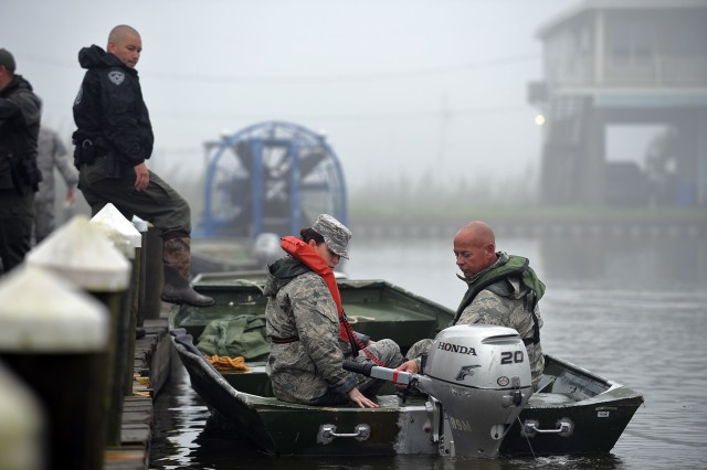 Airmen with the 159th Fighter Wing refine boat operation skills used for water rescue during a disaster response exercise at Myrtle Cove Marine in Port Sulphur, April 5, 2019. Approximately 150 Airmen participated in a DRX with Plaquemines parish emergency management and other state agencies in preparation for the upcoming hurricane season.