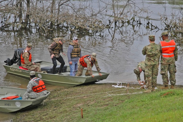 Soldiers with the 225th Engineer Brigade practice boat rescue operations during a Disaster Relief Exercise in Sterlington, Louisiana, April 6, 2019. The Governor's Office of Homeland Security and Emergency Preparedness coordinated various training sites across the state with the LANG to train with various federal, state and local partners who work together during disaster response efforts.