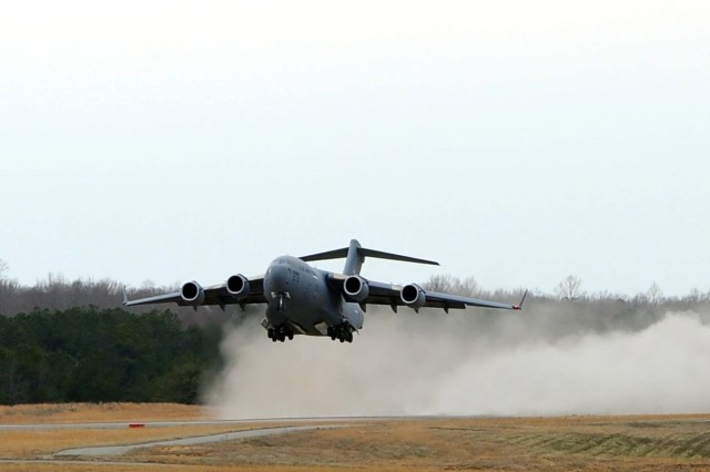 A Charleston Air Force Base, South Carolina C-17 Globemaster III aircraft practices taking off from the assault landing strip on Adkin Drop Zone, Fort A.P. Hill, Virginia on March 27. The C-17s trained at A.P. Hill to hone the skills they need to operate in austere environments while deployed or during contingency operations.U.S. Army photos by Bob McElroy Fort A.P. Hill Public Affairs