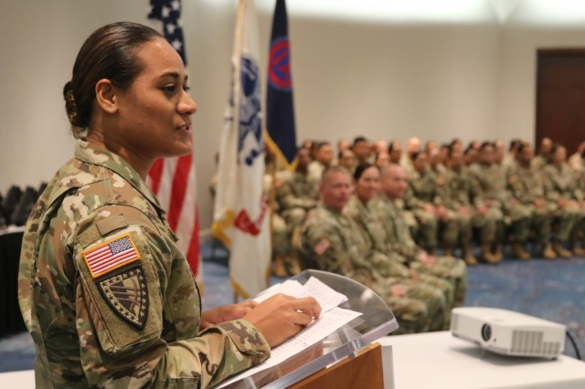 HONOLULU, Hawaii - Capt. Ruth Fa'atiga, company commander of the 962nd Quartermaster (Mortuary Affairs) Co. addresses Detachment 2 of the 962nd at the final welcome home ceremony for the company. The 962nd QM (MA) is unique in its mission and dispersement in that the Soldiers of its formation are from Alaska, American Samoa, Guam, Saipan, the islands of Hawaii and other locations as well, yet they mobilized together with one mission. The company was also deployed to the Central Command region in two separate deployments, Detachment 1 first, which returned last year, and now Detachment 2 has completed their successful deployment. The Soldiers of this geographically dispersed unit all fall under one motto, Respect and Reverence. The Yellow Ribbon Program is hosted by Pacific Army Reserve family programs and attendees are privy to classes, information and one on one assistance tailored to the needs of families and service members.