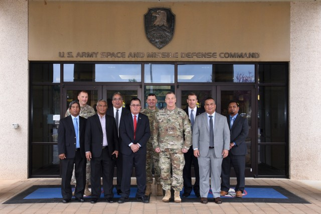 Lt. Gen. James H. Dickinson, commanding general, U.S. Army Space and Missile Defense Command/Army Forces Strategic Command, meets with delegates from the Republic of the Marshall Islands during the group's visit to the command's Redstone Arsenal, Alabama, headquarters April 5.
