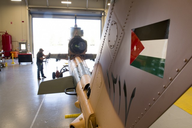A defense industry technician works on final assembly of a Royal Jordanian Air Force AH-1 Cobra helicopter.  The aircraft is being refurbished, under a  foreign military sales contract, at a refurb facility in Huntsville, Alabama, 10 April 2019.  US Army photo by Richard Bumgardner, USASAC Public Affairs.