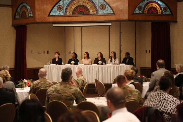 Panelists are seated during the 2019 Women's History Month observance on March 20 at Redstone Arsenal, Ala. From left to right: Lisha Adams, U.S. Army Materiel Command executive deputy to the commanding general; Angelia Walker, NASA/Marshall Space Flight Center deputy manager of space craft and vehicle systems department; Lyndsay Ferguson, Leadership Greater Huntsville president and CEO;  Kim Tycer, AMC legal center chief counsel; Toni Eberhart, Urban Engine executive director; and Dr. Juanita M. Christensen, U.S. Army Combat Capabilities Development Command Aviation & Missile Center executive director.