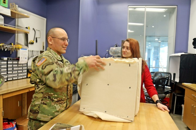 Command Sgt. Maj. Alvaro Pertuz, the senior enlisted advisor for 3rd Brigade Combat Team, 101st Airborne Division (Air Assault) looks at a prototype for a portable fighting position during a tour of the Vanderbilt University Wond'ry after the signing of the Educational Partnership Agreement between Army Futures Command and Vanderbilt Apr. 9. Other items shown during the tour included prosthetics, new materials, and reactive material architectures. (Photo by Staff Sgt. Cody Harding, 3rd BCT Public Affairs.)