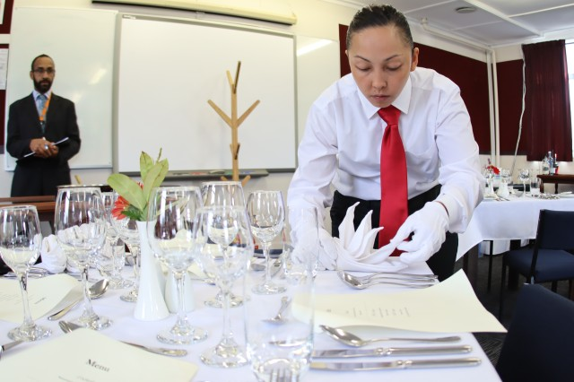 WAIOURU MILITARY CAMP, New Zealand -- U.S. Army Staff Sgt. Francine Talley, a culinary arts specialist assigned to 130th Engineer Brigade, 8th Theater Sustainment Command out of Schofield Barracks, Hawaii, places her folded napkin during a stewardship evaluation for the 42nd Annual Roy Smith Memorial Culinary Competition April 9, 2019 here. Talley served as the steward for her team and earned a silver medal for her flambé presentation. (Photo by U.S. Army Sgt. 1st Class Heather A. Denby, 28th Public Affairs Detachment)