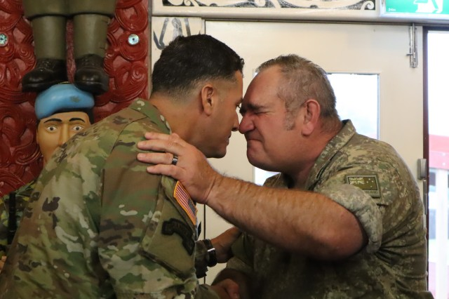 WAIOURU MILITARY CAMP, New Zealand -- U.S. Army Lt. Col. Julio Colongonzalez, commander of the 524th Combat Sustainment Support Battalion, 25th Sustainment Brigade, touches noses with New Zealand Army Warrant Officer Class 2 Aaron Morrison, during a traditional Maori welcome ceremony for visitors April 8, 2019. Colongonzalez is the senior commander on ground for Team Hawaii, a group of culinary specialists competing in the 42nd Annual Roy Smith Memorial Competition held in Waiouru Military Camp, New Zealand. (Photo by U.S. Army Sgt. 1st Class Heather A. Denby, 28th Public Affairs Detachment)