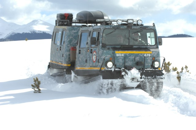 An M973A1 Small Unit Support Vehicle, aka SUSV, clad in emergency lights and digital camouflage, claws its way through the snow at Taylor Park Reservoir near Gunnison, Colo., March 15, 2010. The SUSV, which is capable of traversing almost any terrain, is the primary vehicle used by the Colorado Army National Guard's Snow Response Team. Such vehicles are on standby if needed during the latest storm.