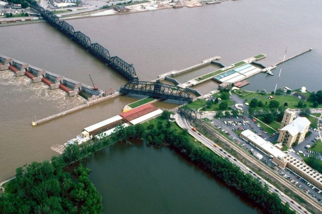 Locks and Dam 15 was the first completed as part of the project to create a nine-foot navigation channel on the Mississippi River and served as a prototype for the project.