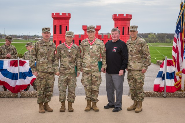 Command Sgt. Maj. Douglas Galick, U.S. Army Engineer School; Capt. Erwin Marciniak and 1st Lt. Jeremy Matsumoto, 299th Brigade Engineer Battalion, Fort Carson, Colorado, representing Team 6; Lt. Gen. Robert Flowers, U.S. Army retired; and Brig. Gen. Robert Whittle, USAES commandant, pose for a photo April 11 on Gammon Field, Fort Leonard Wood, Missouri. Marciniak and Matsumoto took 3rd place in the 2019 Best Sapper Competition.
