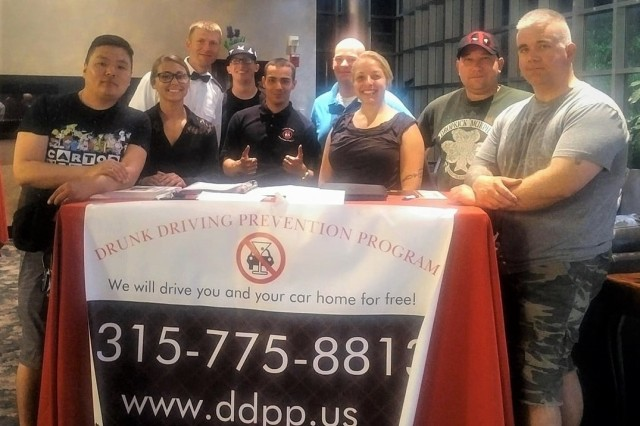 Volunteers from the Fort Drum Chapter for the Drunk Driving Prevention Program set up a booth to help Soldiers to sign up for the program in order to prevent driving home under the influence at a ball held by the 3rd Squadron, 71st Cavalry Regiment Jul. 20, 2018 on Fort Drum, NY.The Fort Drum Drunk Driving Prevention Program (DDPP) was established to offer Soldiers an easy way to get themselves and their vehicles home safely, and free of charge.