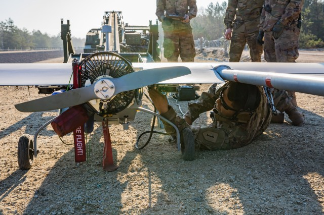 Pfc. Anthony Garcia an Unmanned Aircraft Systems Repairer with the 1st Engineer Battalion, 1st Armored Brigade Combat Team, 1st Infantry Division, conducts preflight checks on an RQ-7 Shadow Unmanned Aerial Vehicle prior to takeoff during a surveillance training mission on an airfield at Camp Trzebien, Poland, April 5, 2019. The Soldiers of Delta Company, 1st Eng. Bat. regularly train on the Shadow, ensuring that they can respond rapidly to real-world surveillance missions. (U.S. Army Photo by Sgt. Jeremiah Woods)