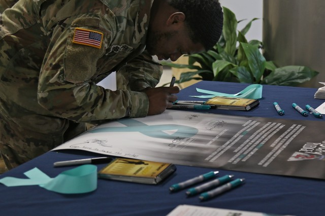 """Soldiers on the 2nd Brigade Combat Team, 10th Mountain Division food service team joined forces with the 2BCT Sexual Harassment/Assault Response and Prevention team to co host The Commando Cafe's Sexual Assault Awareness and Prevention Month observance meal, which featured a """"cake off"""" competition and pledge signing, April 11, 2019, at Fort Drum, New York. The dining facility served surf and turf for lunch as Commandos voted on three SHARP themed cakes, and signed the """"It's Our Duty"""" Pledge in solidarity of SAAPM and survivors of sexual assault. (U.S. Army photo by Staff Sgt. Paige Behringer)"""
