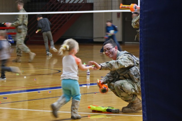 "Miniature warriors from Families across 2nd Brigade Combat Team, 10th Mountain Division, assembled to face Soldiers of the 41st Engineer Battalion during the Commando brigade's second ""Nerf Wars"" match held inside a makeshift battlefield configured throughout the Magrath Sports Complex basketball court, April 10, 2019, at Fort Drum, New York. Foam darts littered the gym floor during the ""just for fun"" event as opposing forces fueled by popcorn and cotton candy engaged in a play firefight. (U.S. Army photo by Staff Sgt. Paige Behringer)"