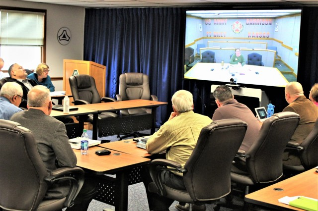 Members of the Fort McCoy, Wis., workforce meet with an Installation Management Command representative during a virtual site visit Oct. 25, 2018, in building 100 as part of the Army Communities of Excellence (ACOE) Program. As one of six garrison finalists, Fort McCoy received the visit that will help determine if the installation will be a winner in the upcoming 2019 ACOE awards. The post won a Silver Award in the 2018 competition and a Bronze Award in the 2017 competition. Army Communities of Excellence is an annual competition that uses the Baldrige Framework for Performance Excellence to evaluate Army installations. Much of the work to participate in the competition is coordinated by the Fort McCoy Plans, Analysis and Integration Office with other agencies supporting. (U.S. Army Photo by Scott T. Sturkol, Public Affairs Office, Fort McCoy, Wis.)