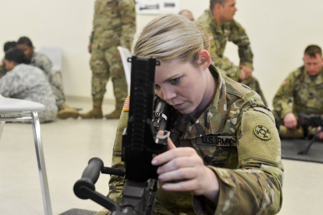 Sgt. Amanda Gleim with the 705th Transportation Company, 310th Sustainment Command (Expeditionary), stares down the barrel of an M240 7.62 mm machine gun during a preliminary marksmanship instruction course March 29, 2019, for Operation Cold Steel III, hosted by the 377th Theater Sustainment Command at Fort McCoy, Wis. Operation Cold Steel III is the Army Reserve's crew-served weapons exercise that focuses on training and qualifying Soldiers to provide lethal and combat ready units to deploy anywhere in the world. (U.S. Army Reserve photo by Sgt. Jasmine Spain/1190th Transportation Surface Brigade)