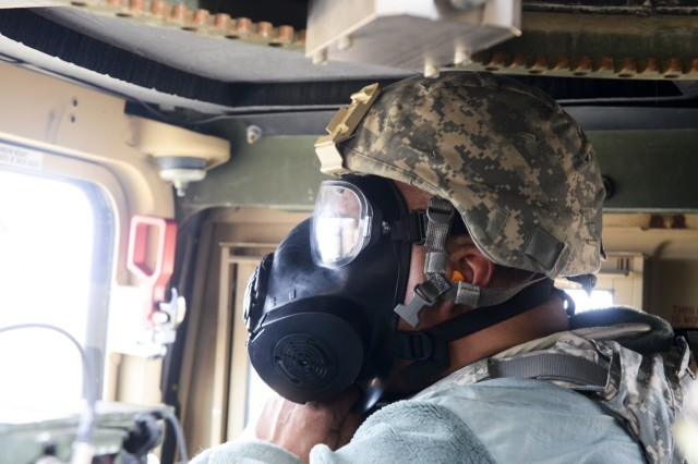 Staff Sgt. Joseph Rezendes, 576th Transportation Detachment, 143rd Sustainment Command (Expeditionary), secures his protective mask on a mounted gunnery range March 27, 2019, during Operation Cold Steel III, which is hosted by 377th Theater Sustainment Command at Fort McCoy, Wis. Operation Cold Steel III is the U.S. Army Reserve's crew-served weapons exercise that focuses on training and qualifying Soldiers to provide lethal and combat ready units to deploy anywhere in the world. (U.S. Army Reserve photo by Sgt. Jasmine Spain/1190th Transportation Surface Brigade)