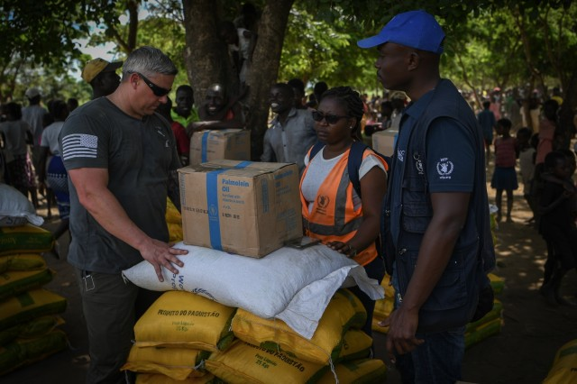 U.S. Army Maj. Eric Buendia, assigned to Combined Joint Task Force - Horn of Africa (CJTF-HOA), helps with the distribution of humanitarian aid in Bebedo, Mozambique, April 8, 2019, during humanitarian relief efforts in the Republic of Mozambique and surrounding areas following Cyclone Idai. Teams from CJTF-HOA, which is leading U.S. Department of Defense support to relief efforts in Mozambique, began immediate preparation to respond following a call for assistance from the U.S. Agency for International Development's Disaster Assistance Response Team. (U.S. Air Force photo by Staff Sgt. Corban Lundborg)