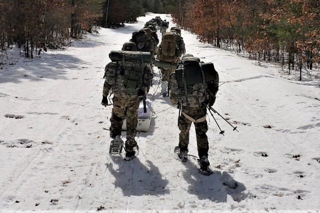 Students in the Cold-Weather Operations Course (CWOC) Class 19-06, which included many Navy Sailors, complete a ruck march in snowshoes March 15, 2019, at Fort McCoy, Wis. CWOC students are trained on a variety of cold-weather subjects, including skiing and snowshoe training as well as how to use ahkio sleds and other gear. Training also focuses on terrain and weather analysis, risk management, cold-weather clothing, developing winter fighting positions in the field, camouflage and concealment, and numerous other areas that are important to know in order to survive and operate in a cold-weather environment. The training is coordinated through the Directorate of Plans, Training, Mobilization and Security at Fort McCoy. (U.S. Army Photo by Joe Ernst, Fort McCoy, Wis.)