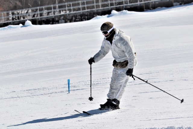 A Navy Sailor who was a student in Fort McCoy Cold-Weather Operations Course (CWOC) Class 19-06 practices skiing March 11, 2019, at Whitetail Ridge Ski Area at Fort McCoy, Wis. In addition to skiing, CWOC students are trained on a variety of cold-weather subjects, including snowshoe training as well as how to use ahkio sleds and other gear. Training also focuses on terrain and weather analysis, risk management, cold-weather clothing, developing winter fighting positions in the field, camouflage and concealment, and numerous other areas that are important to know in order to survive and operate in a cold-weather environment. The training is coordinated through the Directorate of Plans, Training, Mobilization and Security at Fort McCoy. (U.S. Army Photo by Scott T. Sturkol, Public Affairs Office, Fort McCoy, Wis.)