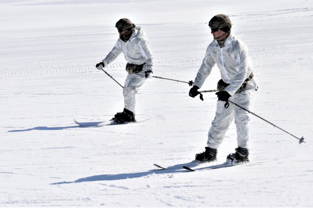 Two Navy Sailors who are students in Fort McCoy Cold-Weather Operations Course (CWOC) Class 19-06 practice skiing March 11, 2019, at Whitetail Ridge Ski Area at Fort McCoy, Wis. In addition to skiing, CWOC students are trained on a variety of cold-weather subjects, including snowshoe training as well as how to use ahkio sleds and other gear. Training also focuses on terrain and weather analysis, risk management, cold-weather clothing, developing winter fighting positions in the field, camouflage and concealment, and numerous other areas that are important to know in order to survive and operate in a cold-weather environment. The training is coordinated through the Directorate of Plans, Training, Mobilization and Security at Fort McCoy. (U.S. Army Photo by Scott T. Sturkol, Public Affairs Office, Fort McCoy, Wis.)