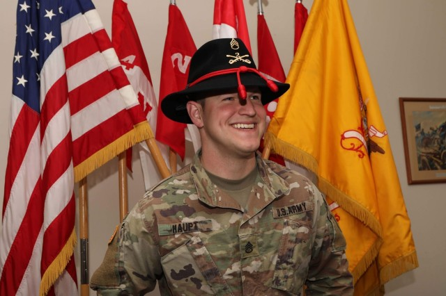 U.S. Army Staff Sgt. Logan Haupt, fire support noncommissioned officer and Warhorse Troop No DUI Saber Program volunteer representative, 4th Squadron, 2d Cavalry Regiment, participates in photo prior to his troop being awarded a 90-day DUI free streamer in Vilseck, Germany, April 4, 2019. The No DUI Saber Program gives Soldiers the support they need to safely commute home. (U.S. Army photo by Sgt. Timothy Hamlin)