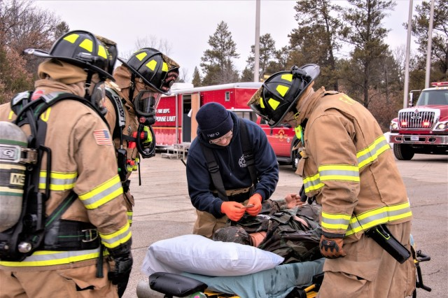 Firefighters with the Directorate of Emergency Services Fire Department participate in a scenario at the post railyard March 20, 2019, for the Vigilant Triad 2019 exercise at Fort McCoy, Wis. Vigilant Triad is a full-scale exercise that helps the installation test its response to a variety of incidents and accidents. Such exercises are part of a continuing effort by the Department of Defense to refine and improve emergency response to natural and man-made disasters. Fort McCoy's Directorate of Plans, Training, Mobilization and Security served as the lead agency for the exercise. The 2019 exercise scenario included a simulated trail derailment where, because of the derailment, some overturned railcars replicated leaking hazardous materials. (U.S. Army Photo by Karen Sampson, Fort McCoy Multimedia-Visual Information Office)