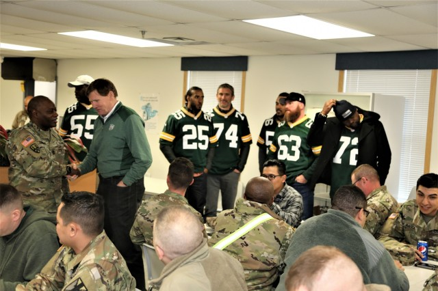 Members of the Green Bay Packers Tailgate Tour meet with Soldiers at a dining facility April 10, 2019, at Fort McCoy, Wis. Packers President/CEO Mark Murphy and six Packers alumni were among the people on the 14th annual Packers Tailgate Tour who visited Fort McCoy. Packers alumni on the tour were Earl Dotson, Nick Barnett, Ryan Grant, Aaron Kampman, Scott Wells, and Bernardo Harris. All of the tour members mingled with Soldiers, signed autographs, and posed for photos. Tour members also visited Fort McCoy's Range 2 to learn about operations for Operation Cold Steel III and Task Force Fortnite. (U.S. Army Photo by Scott T. Sturkol)