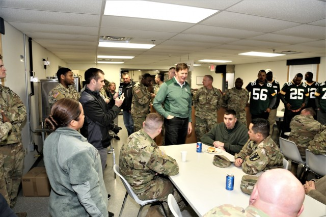 Green Bay Packers President/CEO Mark Murphy talks with Soldiers at a dining facility April 10, 2019, at Fort McCoy, Wis. Murphy and six Packers alumni were among the people on the 14th annual Packers Tailgate Tour who visited Fort McCoy. Packers alumni on the tour were Earl Dotson, Nick Barnett, Ryan Grant, Aaron Kampman, Scott Wells, and Bernardo Harris. All of the tour members mingled with Soldiers, signed autographs, and posed for photos. Tour members also visited Fort McCoy's Range 2 to learn about operations for Operation Cold Steel III and Task Force Fortnite. (U.S. Army Photo by Scott T. Sturkol)
