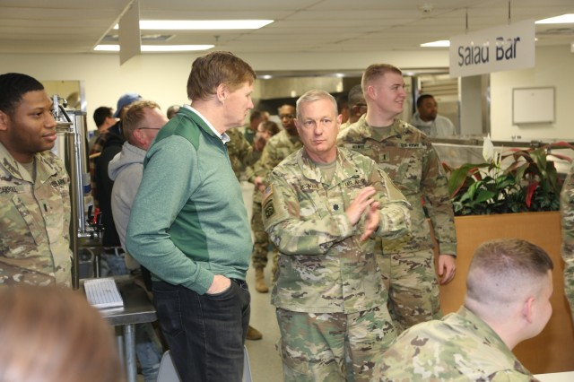 Green Bay Packers President/CEO Mark Murphy visits with Lt. Col. Greg Derner, Task Force Fortnite, at a dining facility April 10, 2019, at Fort McCoy, Wis. Murphy and six Packers alumni were among the people on the 14th annual Packers Tailgate Tour who visited Fort McCoy. Packers alumni on the tour were Earl Dotson, Nick Barnett, Ryan Grant, Aaron Kampman, Scott Wells, and Bernardo Harris. All of the tour members mingled with Soldiers, signed autographs, and posed for photos. Tour members also visited Fort McCoy's Range 2 to learn about operations for Operation Cold Steel III and Task Force Fortnite. (U.S. Army Photo by Scott T. Sturkol)