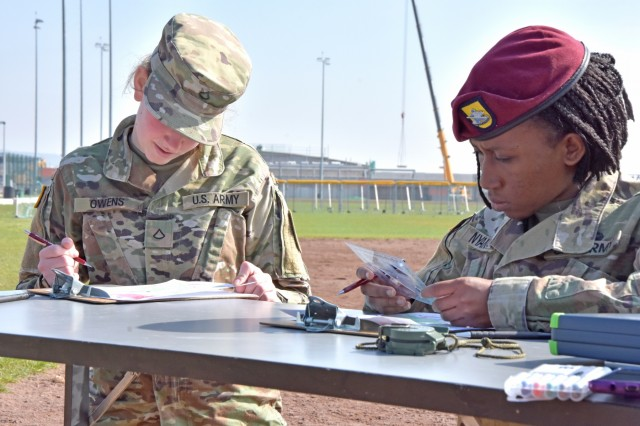 WIESBADEN, Germany - Pfc. Katlynn Owens, U.S. Army Europe, and Spc. Laura Nyanankpe, Headquarters and Headquarters Company, Brigade Support Battalion, 173rd Airborne Combat Team, Vicenza, Italy, locate plotted points on a map as part of U.S. Army Europe's 2019 Paralegal Warrior Competition March 28 at Clay Kaserne. Nyanankpe was the winner for the corporal and below category.