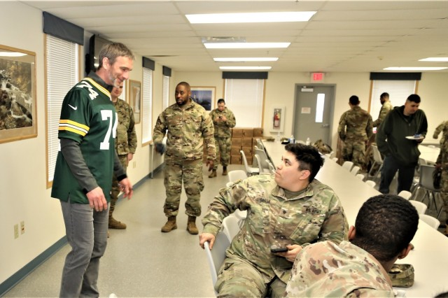 Packers alumni Aaron Kampman with the Green Bay Packers Tailgate Tour meets with Soldiers at a dining facility April 10, 2019, at Fort McCoy, Wis. Packers President/CEO Mark Murphy and six Packers alumni were among the people on the 14th annual Packers Tailgate Tour who visited Fort McCoy. Packers alumni on the tour were Earl Dotson, Nick Barnett, Ryan Grant, Kampman, Scott Wells, and Bernardo Harris. All of the tour members mingled with Soldiers, signed autographs, and posed for photos. Tour members also visited Fort McCoy's Range 2 to learn about operations for Operation Cold Steel III and Task Force Fortnite. (U.S. Army Photo by Scott T. Sturkol)