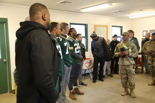 Members of the Green Bay Packers Tailgate Tour meet with Soldiers at Range 2 on April 10, 2019, at Fort McCoy, Wis. Packers President/CEO Mark Murphy and six Packers alumni were among the people on the 14th annual Packers Tailgate Tour who visited Fort McCoy. Packers alumni on the tour were Earl Dotson, Nick Barnett, Ryan Grant, Aaron Kampman, Scott Wells, and Bernardo Harris. All of the tour members mingled with Soldiers, signed autographs, and posed for photos. Tour members visited Fort McCoy's Range 2 to learn about operations for Operation Cold Steel III and Task Force Fortnite. (U.S. Army Photo by Scott T. Sturkol)