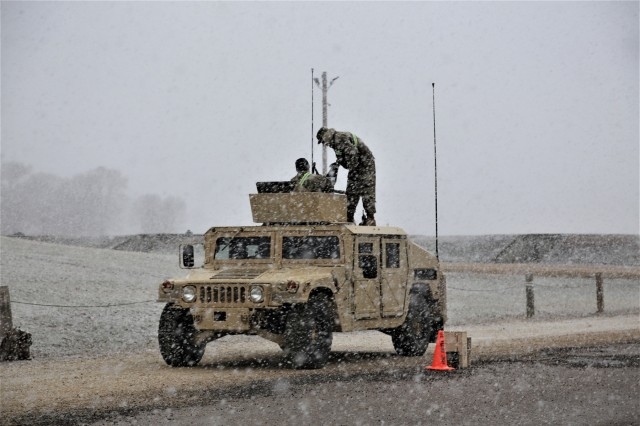 Soldiers conduct operations for Operation Cold Steel III Task Force Fortnite on April 10, 2019, at Range 2 at Fort McCoy, Wis., while a fresh snow comes down. Operation Cold Steel III is a gunnery exercise with Soldiers qualifying on the M2, MK-19, and M240B weapon systems. According to the Army Reserve, the training completed during Operation Cold Steel is critical to ensuring that Army Reserve units and Soldiers are trained and ready to deploy on short notice and bring combat-ready and lethal firepower in support of Army and Joint Force partners around the world. (U.S. Army Photo by Scott T. Sturkol, Public Affairs Office, Fort McCoy, Wis.)